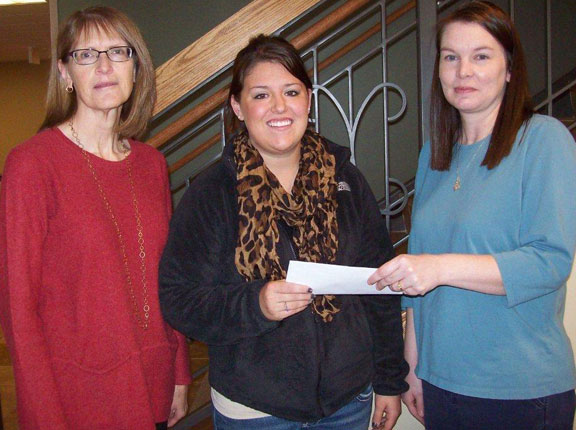 The Zonta Club of Pierre-Fort Pierre awarded Toni Vetter a scholarship for the Fall 2012 semester. Toni is a first-year nursing student attending Capital University Center in Pierre. Pictured are Denise Luckhurst, Zonta Club President, Toni Vetter and Kari Stulken, Zonta Club Scholarship Chair.