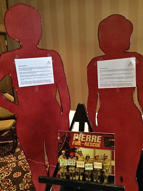 Silhouettes of women killed during domestic violence incidents.