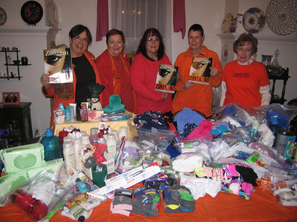 November 25, 2013, Zonta Club of Greeley members with donations to A Women's Place, the battered women's shelter.