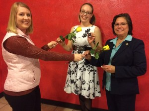 New Members Amelia Kelso and Tessa Cedilla being presented with the traditional yellow rose by past president Tasha Bauman at our November 16, 2017 induction ceremony